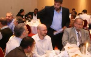 Mohamad Albdawi speaking to Ahmed Shahata at 2009 MAS conference at Overland Park Kansas Marriot
