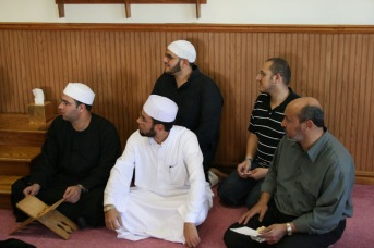 Mohammed Soltan in the back, Mohamed Kohia on the right, Imam Dahee Saeed on the left.